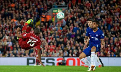 Daniel Sturridge of Liverpool scores against Chelsea