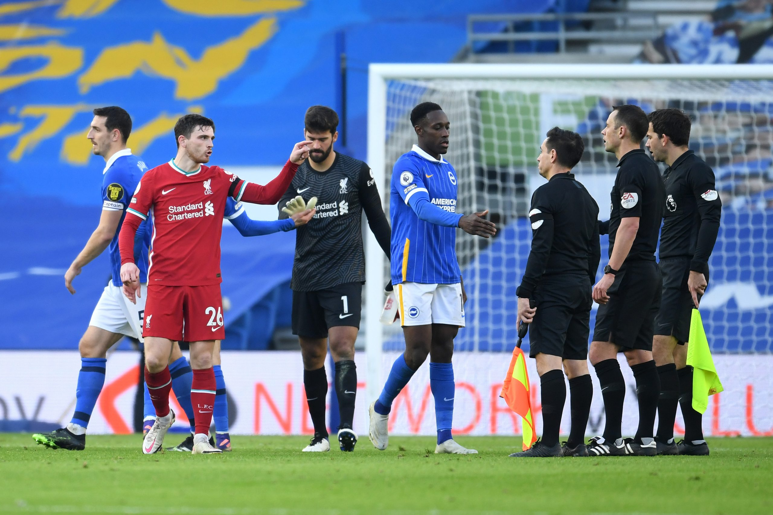 Liverpool players surround Stuart Atwell after the VAR awarded Brighton and Hove Albion a penalty in the closing stages of the game. (GETTY Images)