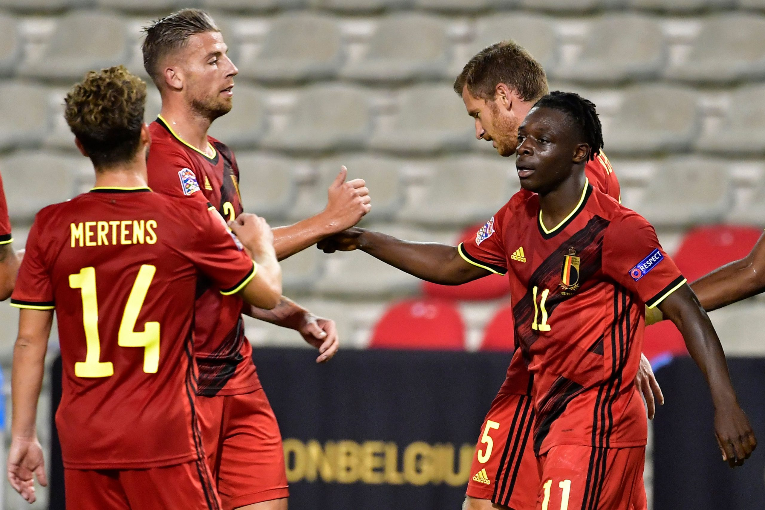 Belgium's forward Jeremy Doku (2ndL) celebrates with teammates after scoring during the UEFA Nations League Group 2 football match between Belgium and Iceland at the King Baudouin stadium in Brussels on September 8, 2020. (Photo by JOHN THYS / AFP) / The erroneous mention[s] appearing in the metadata of this photo by JOHN THYS has been modified in AFP systems in the following manner: [Belgium] instead of [Netherlands]. Please immediately remove the erroneous mention[s] from all your online services and delete it (them) from your servers. If you have been authorized by AFP to distribute it (them) to third parties, please ensure that the same actions are carried out by them. Failure to promptly comply with these instructions will entail liability on your part for any continued or post notification usage. Therefore we thank you very much for all your attention and prompt action. We are sorry for the inconvenience this notification may cause and remain at your disposal for any further information you may require. (Photo by JOHN THYS/AFP via Getty Images)