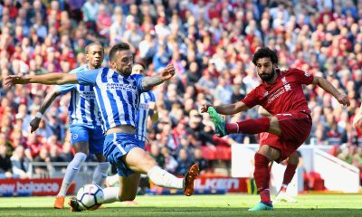 LIVERPOOL, ENGLAND - MAY 13: Mohamed Salah of Liverpool scores his sides first goal during the Premier League match between Liverpool and Brighton and Hove Albion at Anfield on May 13, 2018 in Liverpool, England. (Photo by Michael Regan/Getty Images)