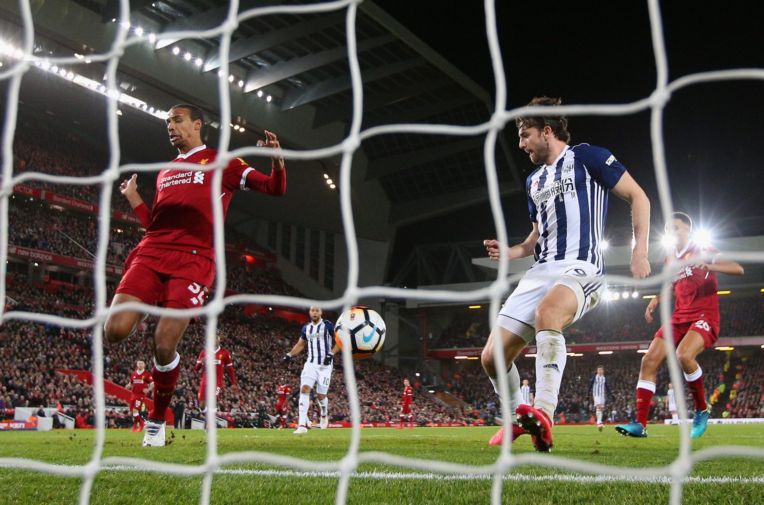 LIVERPOOL, ENGLAND - JANUARY 27: Jay Rodriguez of West Bromwich Albion watches on as Joel Matip of Liverpool scores an own goal during The Emirates FA Cup Fourth Round match between Liverpool and West Bromwich Albion at Anfield on January 27, 2018 in Liverpool, England. (Photo by Alex Livesey/Getty Images)