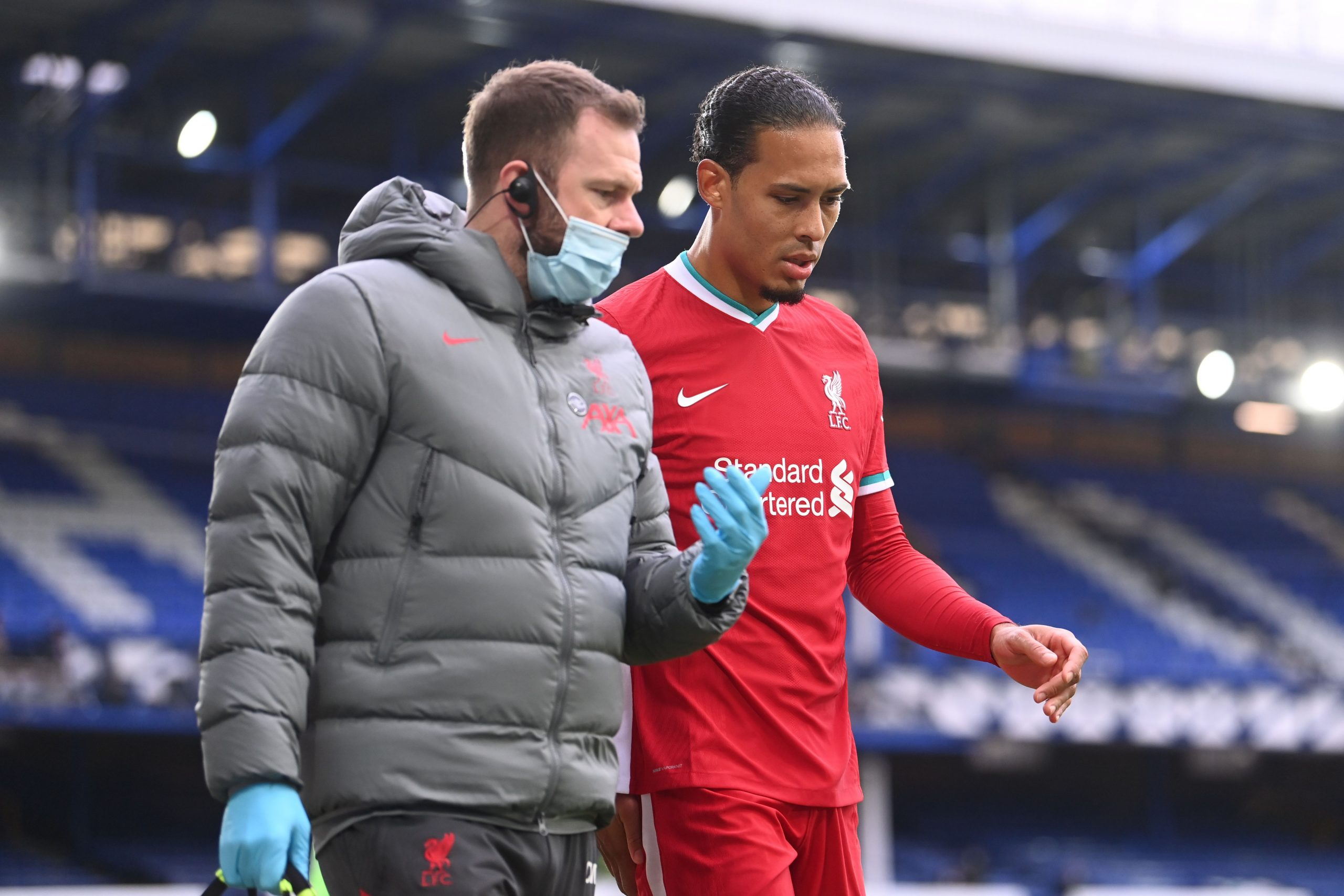 Liverpool's Dutch defender Virgil van Dijk leaves the field injured during the Merseyside derby. (GETTY Images)