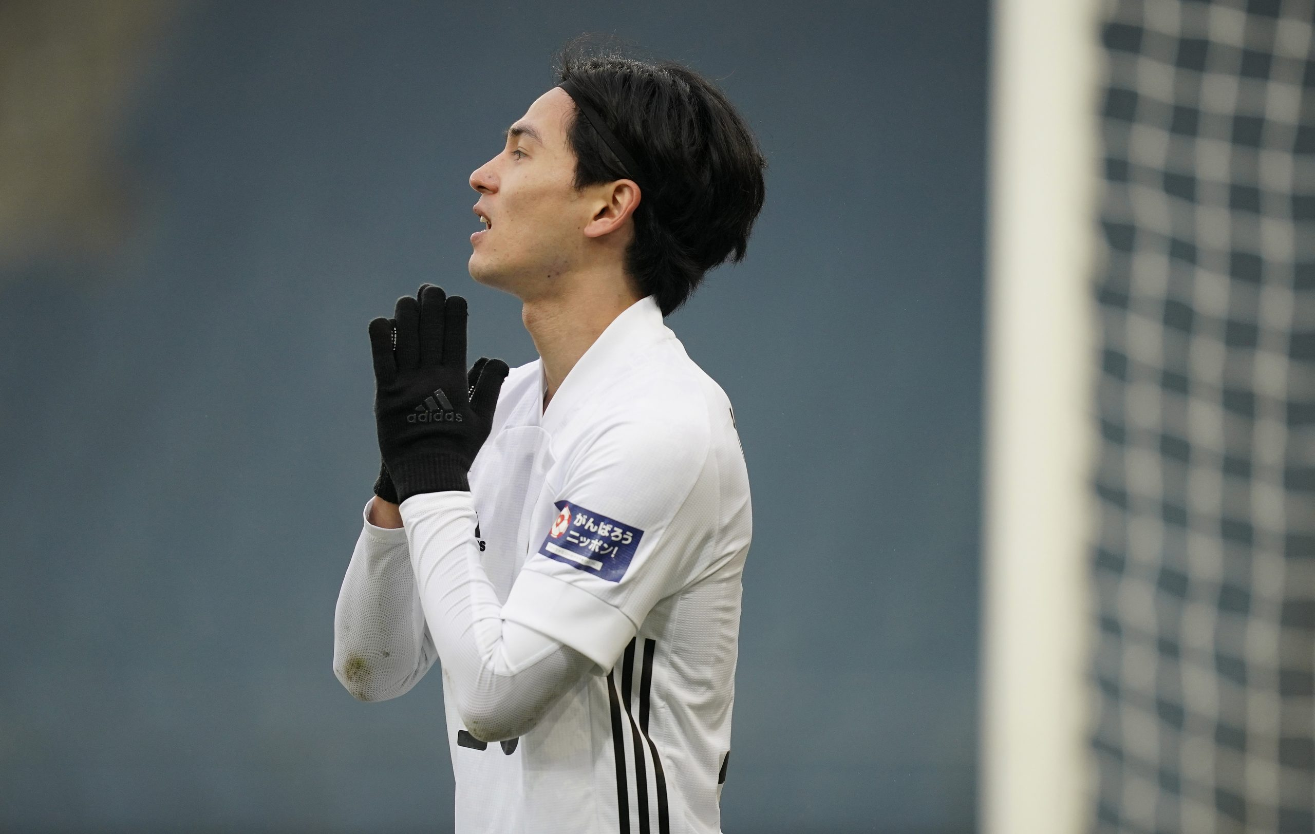 GRAZ, AUSTRIA - NOVEMBER 13: Takumi Minamino of Japan reacts during the international friendly match between Japan and Panama at Merkur Arena on November 13, 2020 in Graz, Austria. (Photo by Christian Hofer/Getty Images)