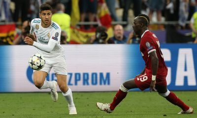 Sadio Mane of Liverpool (R) in action against Marco Asensio from Real Madrid in the UEFA Champions League.